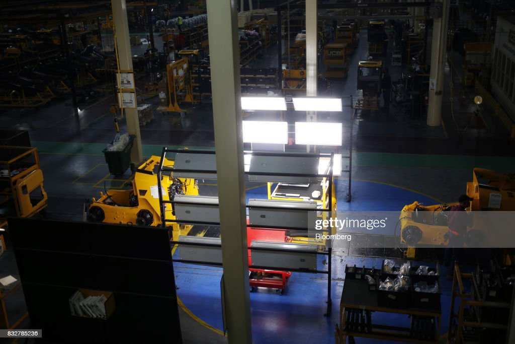 Construction vehicles sit on the assembly line at the JC Bamford Excavators LTD. (JCB) manufacturing plant in Pooler, Georgia, U.S., on Friday, Aug. 11, 2017. The Federal Reserve is scheduled to release industrial production figures on August 17. Photographer: Luke Sharrett/Bloomberg via Getty Images