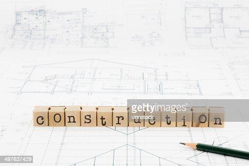 Construction word blocks stack on blueprints and floor plan stock construction word blocks stack on blueprints and floor plan stock photo malvernweather Images