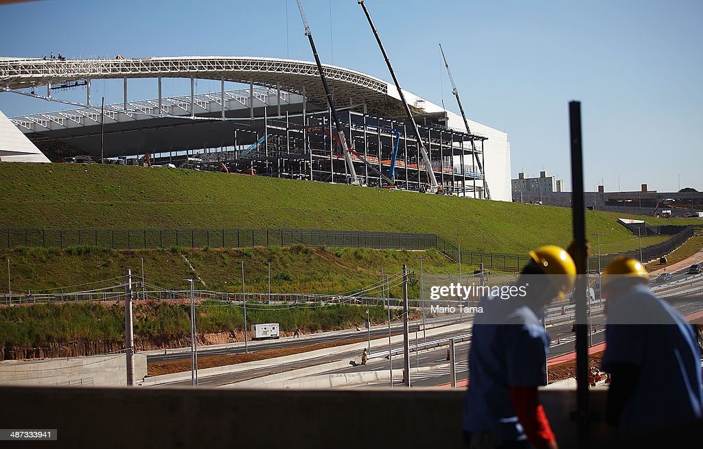 Construction work continues at the Itaquerao stadium, also known as Arena de Sao Paulo and Arena Corinthians, on April 29, 2014 in Sao Paulo, Brazil. The stadium is scheduled to host the opening World Cup match on June 12 between Brazil and Croatia. Some 20,000 temporary seats are being constructed behind the goals to boost the seating capacity to nearly 70,000.