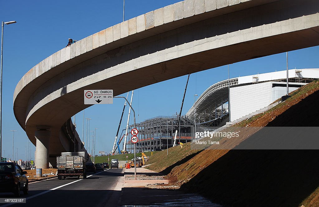 Construction work continues on an access road at the Itaquerao stadium, also known as Arena de Sao Paulo and Arena Corinthians, on April 29, 2014 in Sao Paulo, Brazil. The stadium is scheduled to host the opening World Cup match on June 12 between Brazil and Croatia. Some 20,000 temporary seats are being constructed behind the goals to boost the seating capacity to nearly 70,000.