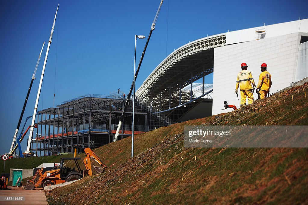 Construction work continues on temporary seating (LEFT C) at the Itaquerao stadium, also known as Arena de Sao Paulo and Arena Corinthians, on April 29, 2014 in Sao Paulo, Brazil. The stadium is scheduled to host the opening World Cup match on June 12 between Brazil and Croatia. Some 20,000 temporary seats are being constructed behind the goals to boost the seating capacity to nearly 70,000.