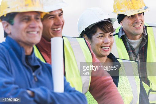 Construction work crew with female worker
