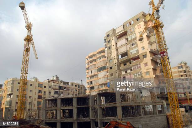 Construction work in progress where Israeli bombs destroyed Hezbollah's offices during their aerial attacks in June 2006 in the heart of Dahiya in...