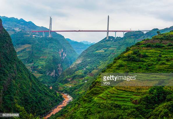 Construction work on the Beipan River expressway bridge on September 10 2016 in Bijie Guizhou Province of China The 13414meterlong Beipan River...