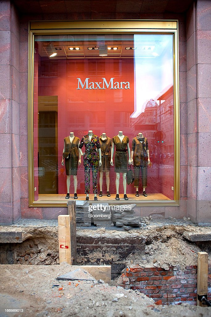 Construction work on the pavement is seen outside a MaxMara fashion store in Berlin, Germany, on Thursday, April 18, 2013. Germany's economy is shrugging off a contraction at the end of last year and starting to grow due to revived exports and rising private consumption, the country's leading economic institutes said. Photographer: Krisztian Bocsi/Bloomberg via Getty Images