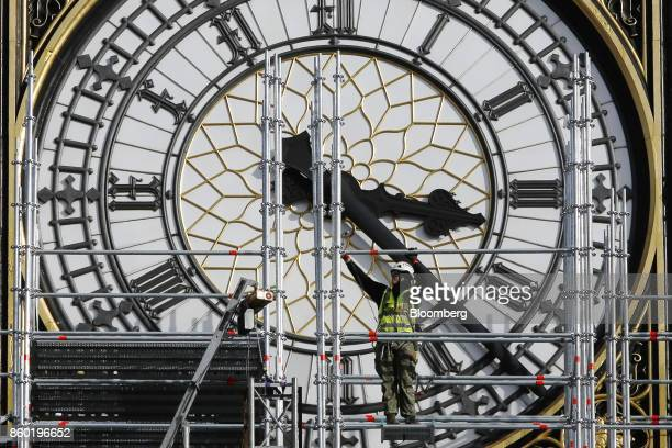 A construction worker adjusts scaffolding outside the clock face on Elizabeth Tower also known as 'Big Ben' in London UK on Wednesday Oct 11 2017 UK...
