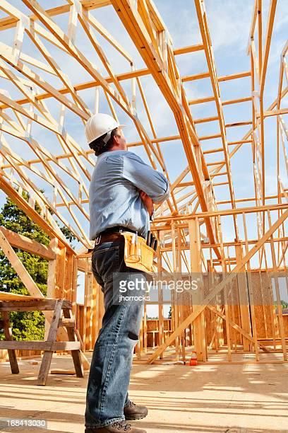 Construction Worker Admiring Handiwork