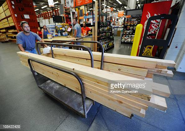 Construction worker Alex Sierra buys lumber for home framing at the Home Depot store on August 17 2010 in Los Angeles California Atlantabased Home...