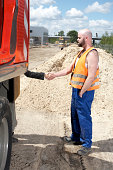 Construction worker and woman shaking hands