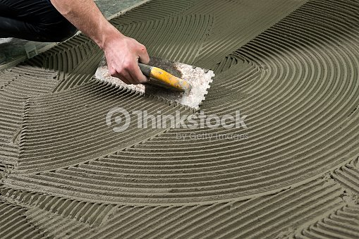 Construction Worker Applying Ceramic Glue : Stock Photo