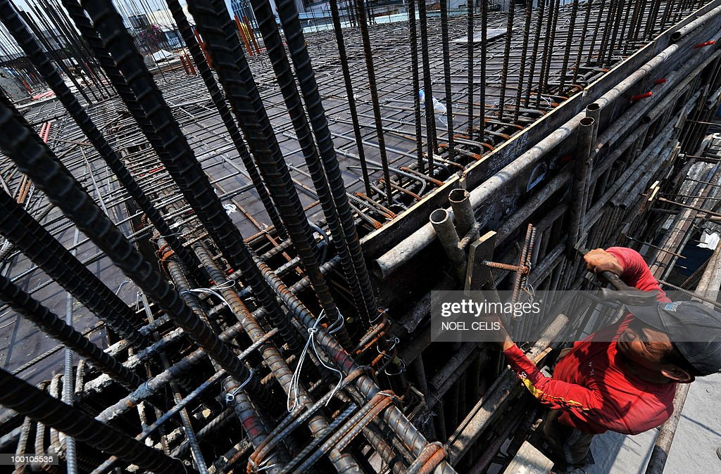 A construction worker arranges steelbars