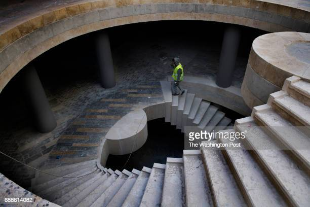 A construction worker ascends from an underground parking lot at Rawabi a highend multiuse development in Rawabi Israel on April 4 2017 Rawabi is a...