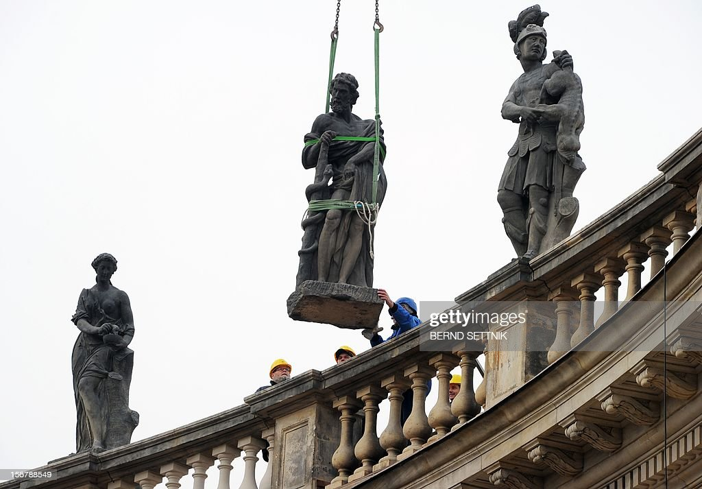 Construction worker assemble the Hercules statue of the colonnade of the New Palace in Potsdam, eastern Germany, on November 21, 2012. 1.2 million euros have been spent for the restoration of the sand stone statues.