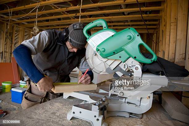 Construction worker at a circular saw