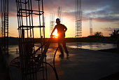 Construction Worker At Site During Sunset