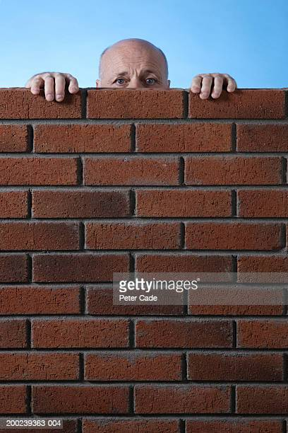 Construction worker behind wall