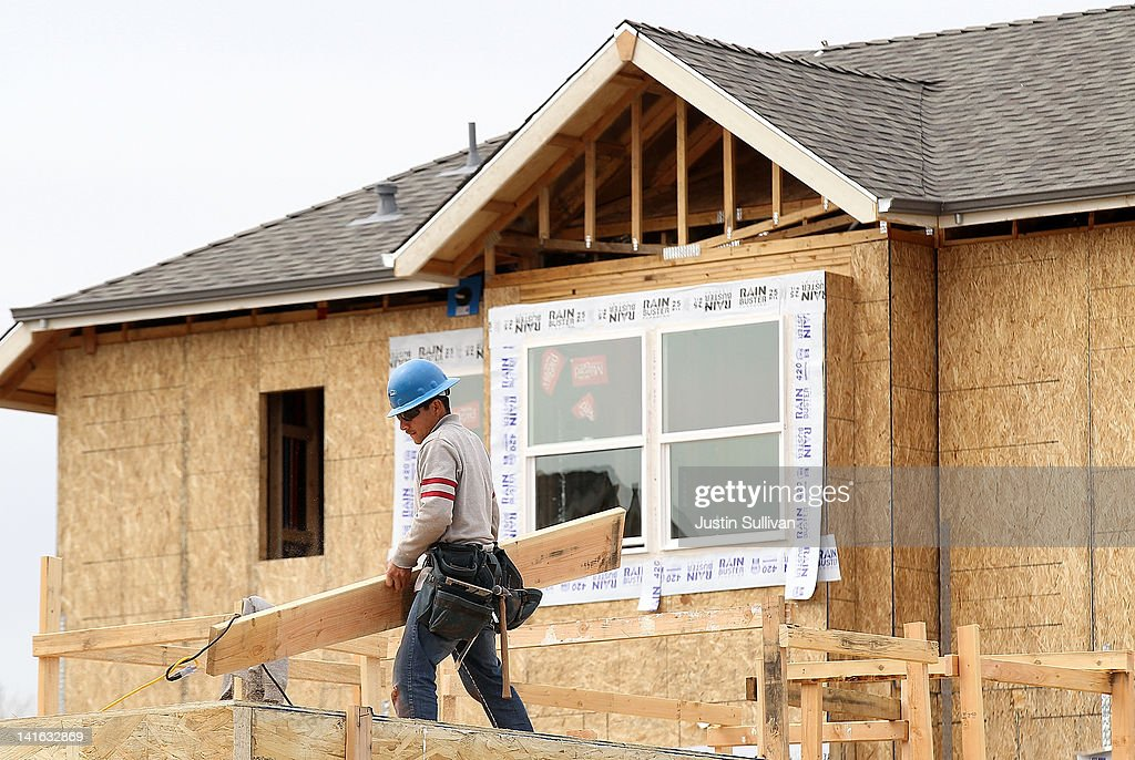 A construction worker carries lumber while working on new homes at the Arbor Rose housing development on March 20, 2012 in San Mateo, California. The Commerce Department reported today that new building permits rose 5.1 percent in February, the highest since October 2008.