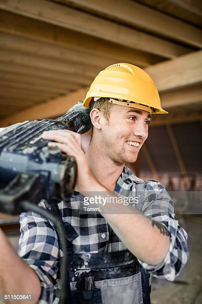 Construction Worker Carrying Jackhammer