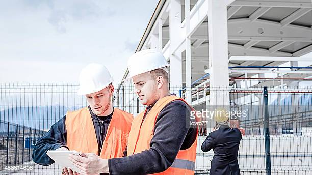 Construction worker checking plans