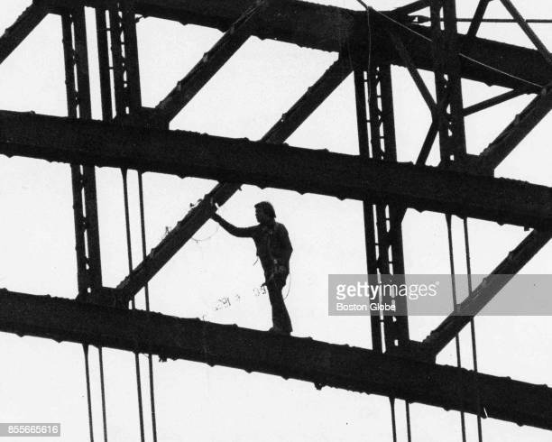 A construction worker checks on unexploded explosives on Arch Bridge in Vermont Dec 5 1982
