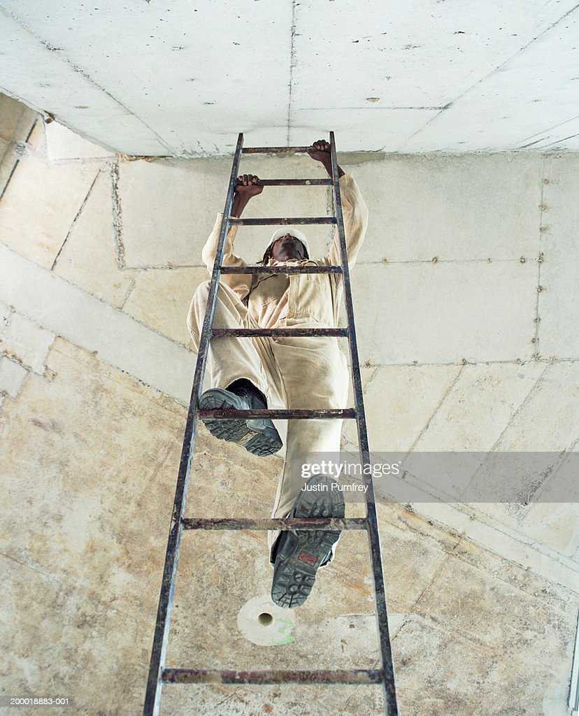 Construction Worker Climbing Ladder View From Below Stock Photo ... for Worker Climbing Ladder  110ylc