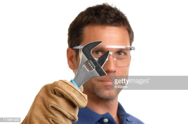 Construction Worker Contractor Mechanic Holding Adjustable Wrench on White