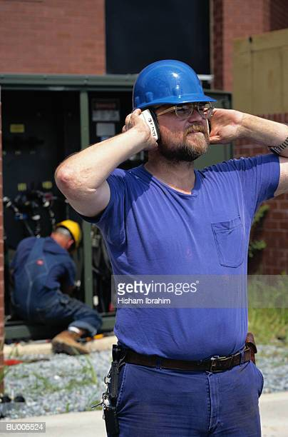Construction Worker Covering his Ears