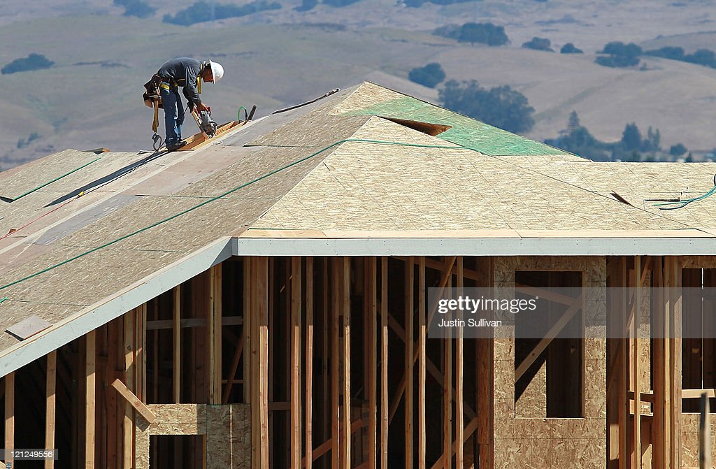 A construction worker cuts a piece of wood on the top of a home under construction at a new housing development on August 16, 2011 in Petaluma, California. The Commerce Department reported that new home construction fell in July with homebuilders beginning construction on a seasonally adjusted 604,000 homes for the month, a 1.5 percent decline from June.