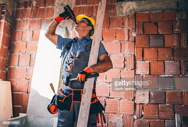 Construction worker drinking beer