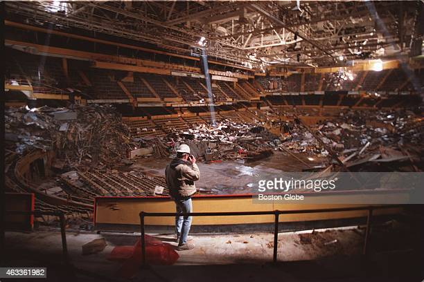 Construction worker Ed Sullivan takes time out during his lunch hour to photograph the inside of the Boston Garden He is part of the demolition crew...