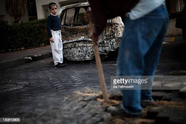 A construction worker fixes the hole in the ground made by a longrange Grad rocket yesterday that hit the area on October 30 2011 in Ashdod Israel...