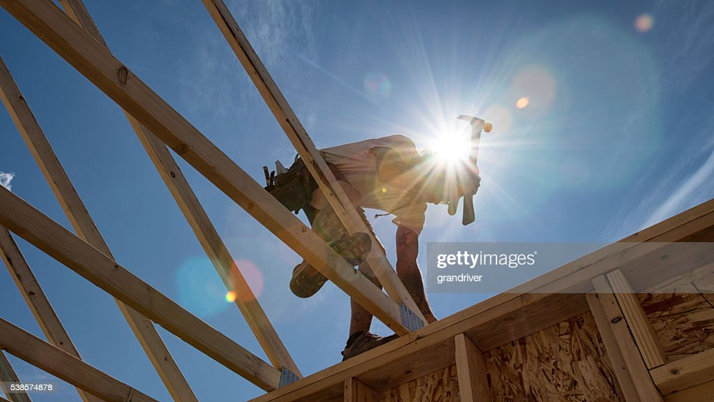 Construction Worker Framing A Building : Stock Photo