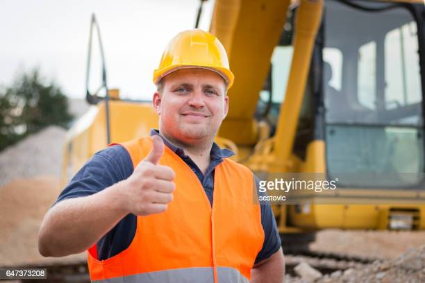 Construction worker giving thumbs up