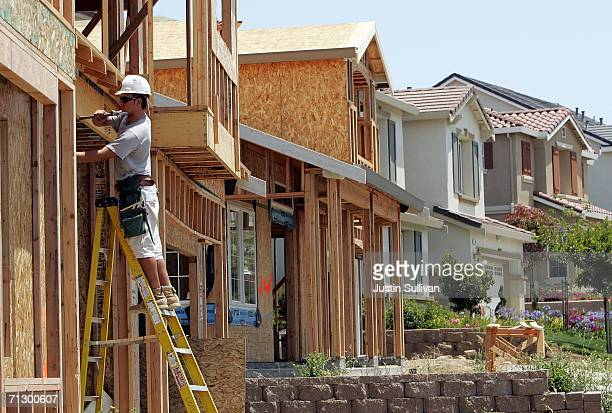 A construction worker hammers nails into the framing of a new home in a development June 26 2006 in Richmond California A report issued by the US...