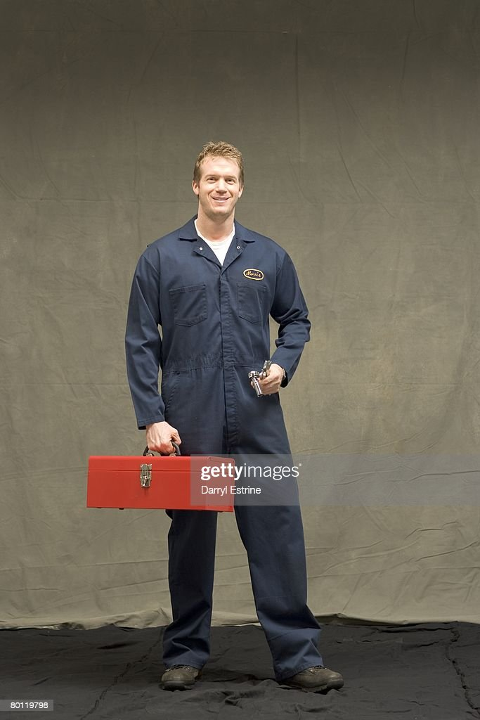 Construction worker holding tool box
