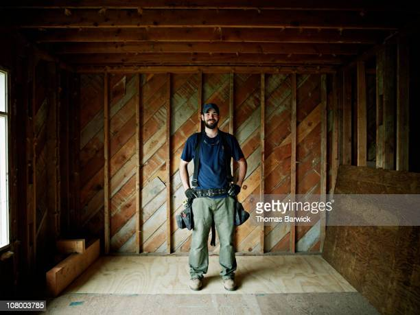 Construction worker in home under construction