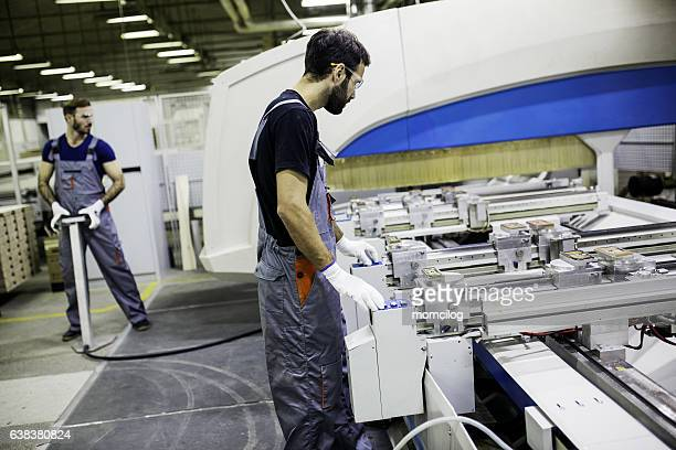 Construction worker inside factory