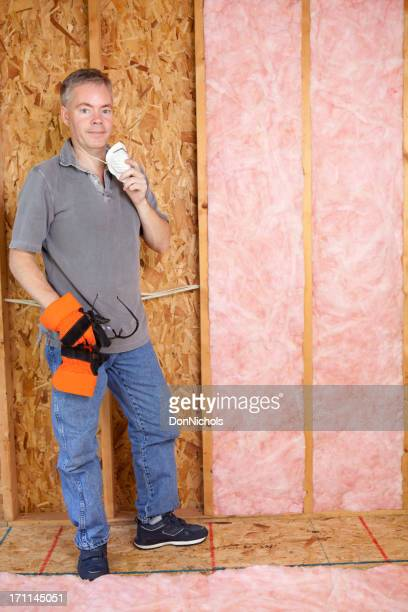 Construction Worker Installing Insulation