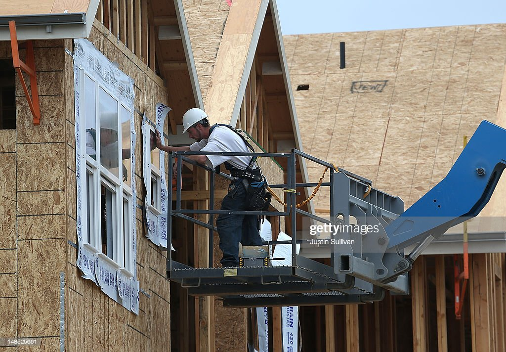 A construction worker installs a window in a new home at the Arbor Rose housing development on July 18, 2012 in San Mateo, California. The Commerce Department reported that housing starts surged 6.9% in June, the highest increase since October 2008.