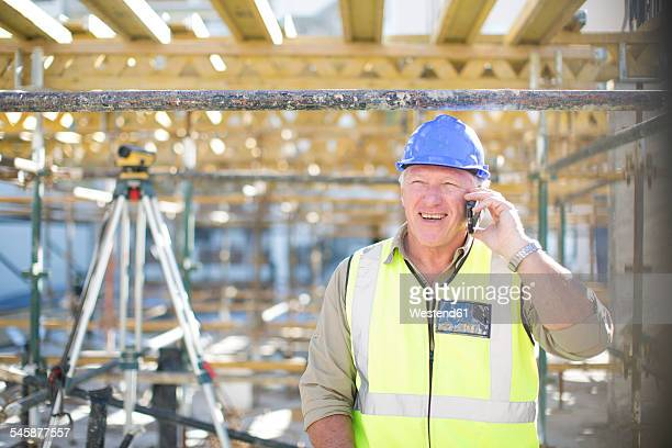 Construction worker on cell phone in construction site
