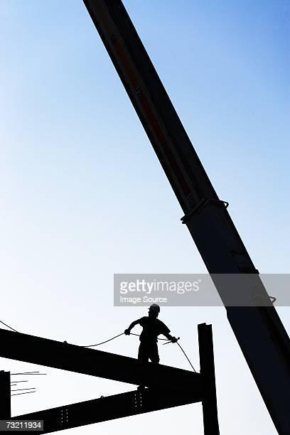 Construction worker on framework
