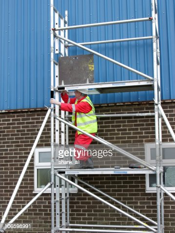 construction worker on portable scaffolding
