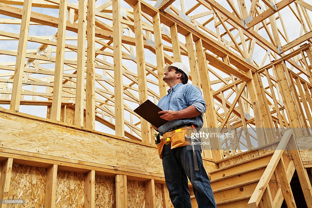 Construction Worker on Site with Clipboard : Stock Photo