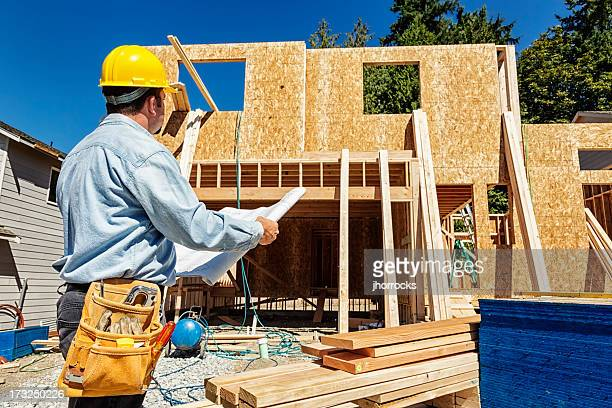 Building contractor stock photos and pictures getty images for My contractor plan