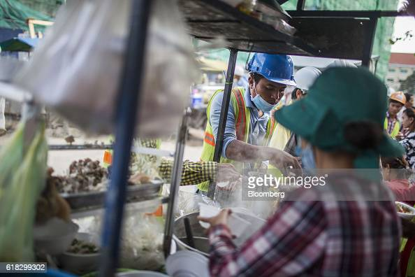 A construction worker orders noodles for breakfast at a food stall in Phnom Penh Cambodia on Monday Oct 24 2016 Cambodia has a population of about 16...