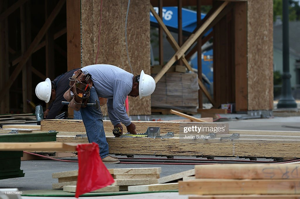 A construction worker prepares to cut lumber while building a new home at the Arbor Rose housing development on July 18, 2012 in San Mateo, California. The Commerce Department reported that housing starts surged 6.9% in June, the highest increase since October 2008.