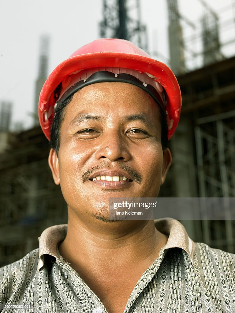 Construction worker smiling, close-up, portrait