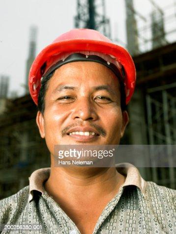 Construction worker smiling, close-up, portrait
