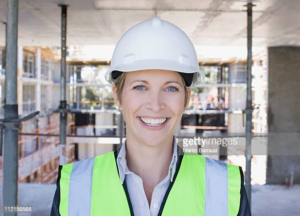Construction worker smiling on construction site