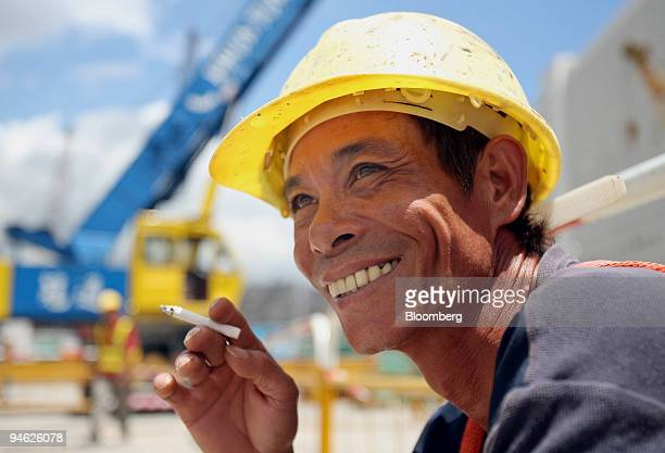 A construction worker smokes a cigarette at the KCR's Kowloon Southern Link construction site in Hong Kong China on Wednesday August 16 2006